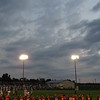 Moon at sunset, over the Alexandria High School football team.<br /> <br /> Photographer's Name: Harry Van Noy<br /> Photographer's City and State: Lafayette Township, Ind.