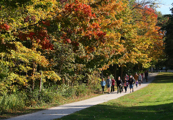 Naturalist Riley leading a historical hike at Mounds Park along a colorful trail.<br /> <br /> Photographer's Name: Jerry Byard<br /> Photographer's City and State: Anderson, Ind.