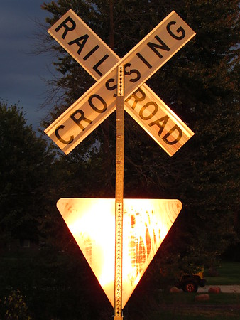 Golden-sun reflected on a railroad crossing sign.<br /> <br /> Photographer's Name: Harry Van Noy<br /> Photographer's City and State: Lafayette Township, Ind.