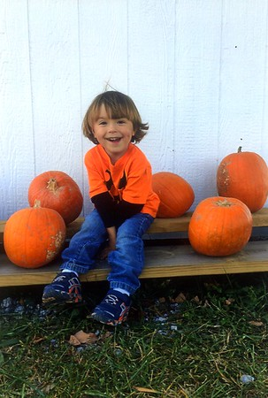 Eddie Favorite, grandson of Nancy Favorite, at a pumpkin patch.<br /> <br /> Photographer's Name: Nancy Favorite<br /> Photographer's City and State: Anderson, Ind.