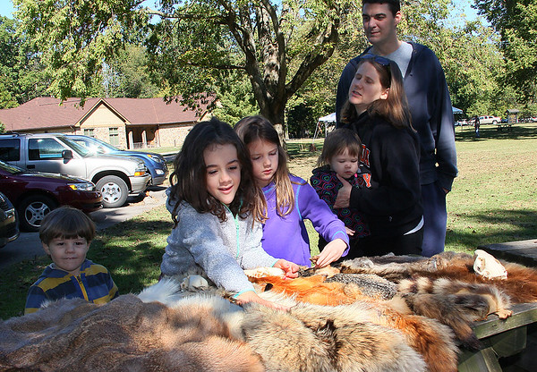Children touching the 'fur table' at Mounds Park during Archaeology Day.<br /> <br /> Photographer's Name: Jerry Byard<br /> Photographer's City and State: Anderson, Ind.