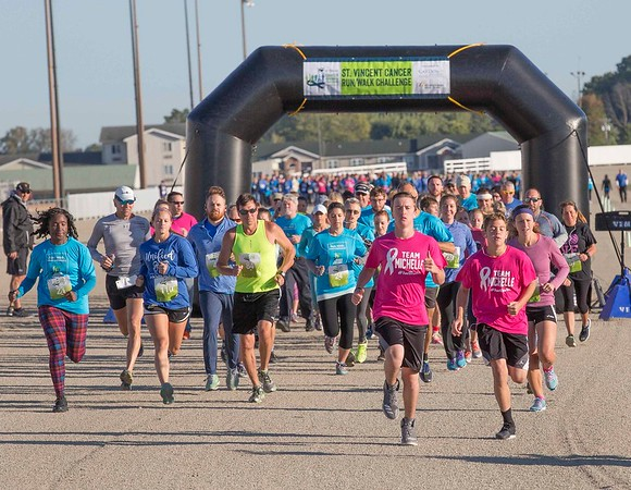 Runners take off on the track at Hoosier Park for the St. Vincent Cancer Challenge. The 5K run and 1-mile honor walk benefited the St. Vincent Anderson Cancer Center.<br /> <br /> Photographer's Name: Dale Pickett<br /> Photographer's City and State: Anderson, Ind.