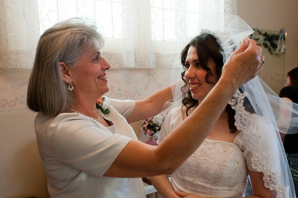 My mother, Cathy Cosby, helping me get ready for my wedding.<br /> <br /> Photographer's Name: Beckisue Knight<br /> Photographer's City and State: Anderson, IN