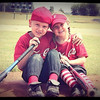 Thaiden and sister Lucy Alexander posing for a picture at the end of baseball season.<br /> <br /> Photographer's Name: Jeff Alexander<br /> Photographer's City and State: Frankton, Ind.