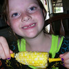 Gracie, age 7, enjoying some corn on the cob.<br /> <br /> Photographer's Name: Linda Kilgore<br /> Photographer's City and State: Anderson, Ind.