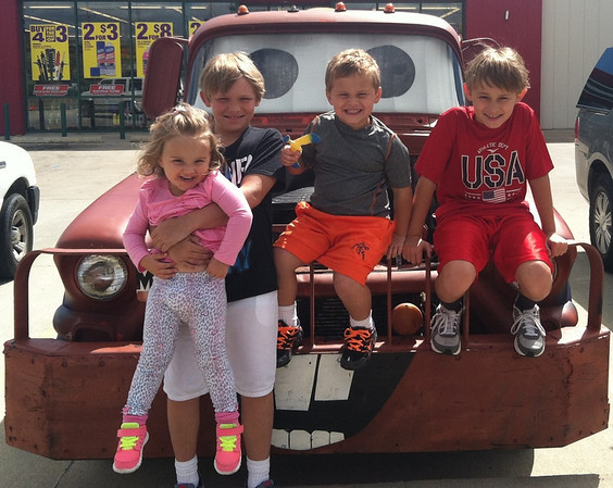 Had to snap a picture of my kiddos Branlin, Avery, Thias, and Nolan with Tow Mater as he was parked at O'Reilly Auto Parts. We couldn't resist. <br /> <br /> Photographer's Name: Molly McCoy<br /> Photographer's City and State: Anderson, Ind.
