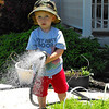 """""""Yard work:"""" grandson Eli Coxe watering the yard.<br /> <br /> Photographer's Name: J.R. Rosencrans<br /> Photographer's City and State: Alexandria, Ind."""