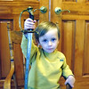 """Why grandfathers shouldn't babysit:"" Eli Coxe with my U.S. Marine Corps sword.<br /> <br /> Photographer's Name: J.R. Rosencrans<br /> Photographer's City and State: Alexandria, Ind."