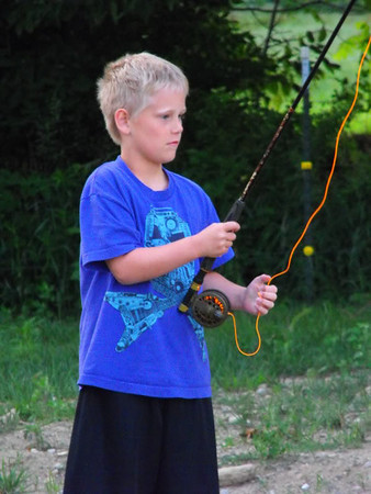 """""""Focused on fishing:"""" Lucas Coxe fly fishing at the farm pond.<br /> <br /> Photographer's Name: J.R. Rosencrans<br /> Photographer's City and State: Alexandria, Ind."""
