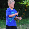 """Focused on fishing:"" Lucas Coxe fly fishing at the farm pond.<br /> <br /> Photographer's Name: J.R. Rosencrans<br /> Photographer's City and State: Alexandria, Ind."