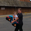 Henry getting help from his big brother when the battery died at the power wheel race at the Alexandria Grand Prix. <br /> <br /> Photographer's Name: Jennifer Jessie<br /> Photographer's City and State: Frankton, Ind.