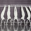 The 1967 MHHS Gymnastics team photo of handstands around the gym floor Pirate at center court.<br /> <br /> Photographer's Name: Ed Cates<br /> Photographer's City and State: Anderson, Ind.