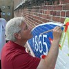 Mayor Smith puts finishing touches on the Sesquicentennial mural.<br /> <br /> Photographer's Name: Brian Hochstetler<br /> Photographer's City and State: Anderson, Ind.
