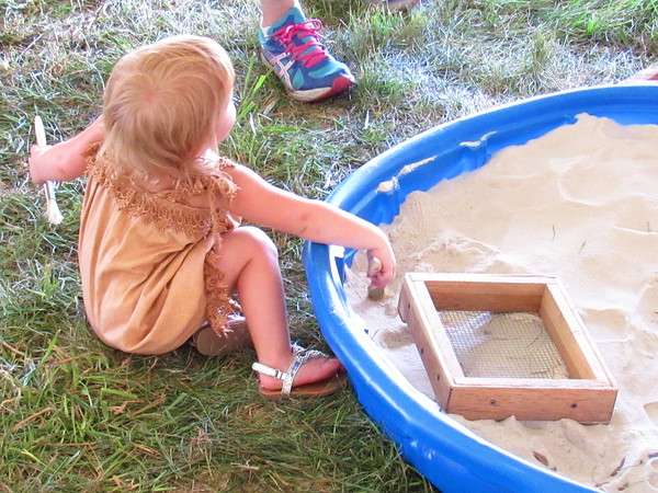Young girl, looking for artifacts in a sandbox, at the Andersontown Powwow.<br /> <br /> Photographer's Name: Harry Van Noy<br /> Photographer's City and State: Lafayette Township, Ind.