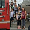 This is Ryan and Natalie Long, Bennett and Carter Sovern, and Avery Cuneo, at Alexandria's Public Safety Day last week. Ryan is selling mums for Boy Scouts. Would you like to buy any?<br /> <br /> Photographer's Name: Carrie Long<br /> Photographer's City and State: Alexandria, Ind.