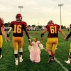 This is two-year-old Charlotte Cambridge, of Alexandria, delivering the game ball with the Alexandria Tiger football team. It was Homecoming last week.<br /> <br /> Photographer's Name: Carrie Long<br /> Photographer's City and State: Alexandria, Ind.