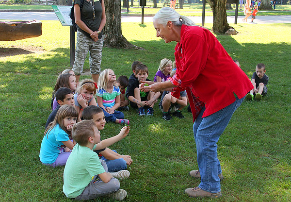 A young school group at Mounds Park being taught some nature things by Kate Bell.<br /> <br /> Photographer's Name: Jerry Byard<br /> Photographer's City and State: Anderson, Ind.