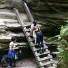 Two gals at Turkey Run State Park are helping their dogs climb the ladders on Trail 3.<br /> <br /> Photographer's Name: Jerry Byard<br /> Photographer's City and State: Anderson, Ind.