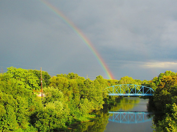 A rainbow over White River in downtown Anderson.<br /> <br /> Photographer's Name: Micah Mitchell<br /> Photographer's City and State: Anderson, Ind.