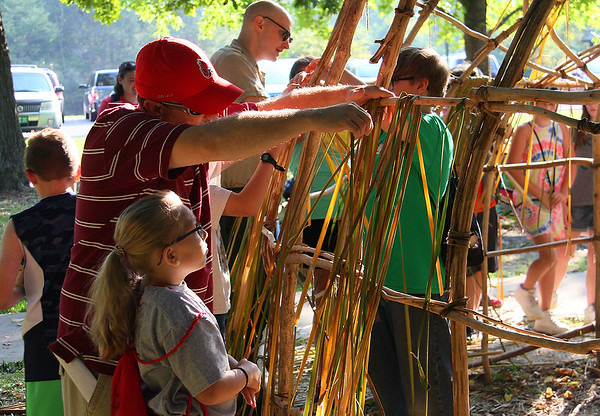 A group of school kids and adults are working on the Wigwam at Mounds Park during a field trip.<br /> <br /> Photographer's Name: Jerry Byard<br /> Photographer's City and State: Anderson, Ind.