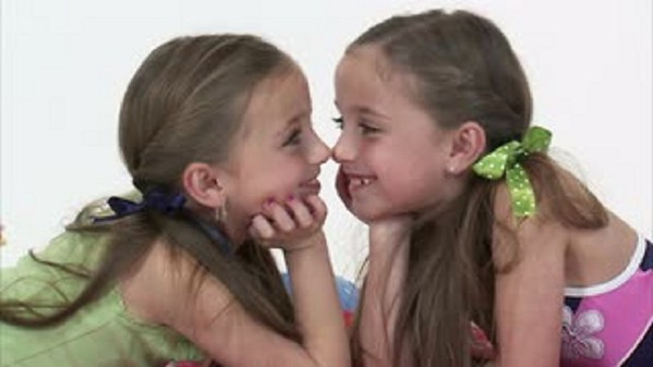 My twin nieces Abby and Hanna, 9, of Anderson taking a break from their songwriting to have a stare down contest <br /> <br /> Photographer's Name: Nicole Winkler<br /> Photographer's City and State: Anderson, Ind.