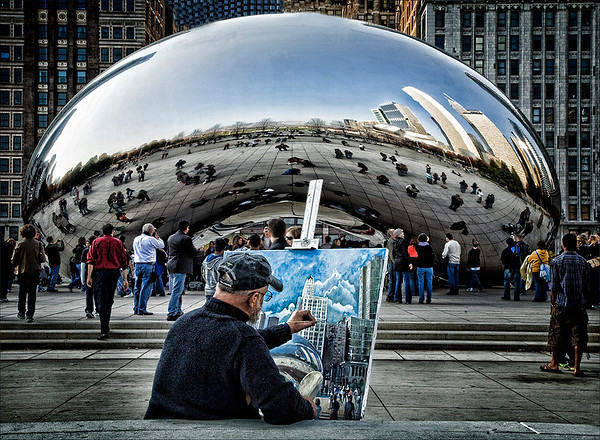 """Chicago's outdoor sculpture, Cloud Gate, also known as """"The Bean"""" with an artist painting the sculpture in Millenium Park.<br /> <br /> Photographer's Name: Barbara Grimball<br /> Photographer's City and State: Anderson, Ind."""