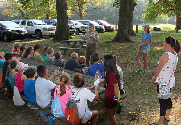 Naturalist Ariel at Mounds Park talking with kids about types of plants found in nature.<br /> <br /> Photographer's Name: Jerry Byard<br /> Photographer's City and State: Anderson, Ind.