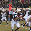 Photo courtesy of DON TOOTHAKER/toothakerphoto.com Navy quarterback Kennan Reynolds scrambles on Saturday in Philadelphia during the Army v. Navy football game held at Lincoln Financial Field.  Army fell for the 11th straight year to Navy, 17-13.