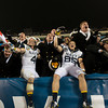 Photo courtesy of DON TOOTHAKER/toothakerphoto.com Navy players and Midshipmen celebrate on Saturday in Philadelphia during the Army v. Navy football game held at Lincoln Financial Field.  Army fell for the 11th straight year to Navy, 17-13.