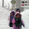 Photo courtesy of John McElhenny/Gloucester Daily Times. Ruby McElhenny, 4, Daniela Orlando, 3, and Luke McElhenny, 6, brave the blizzard to have breakfast at Mamie's Kitchen at 9 on Saturday morning. The three friends, who live next door to each other on Allen Street, rode in sleds pulled by their parents along the snowy roads.