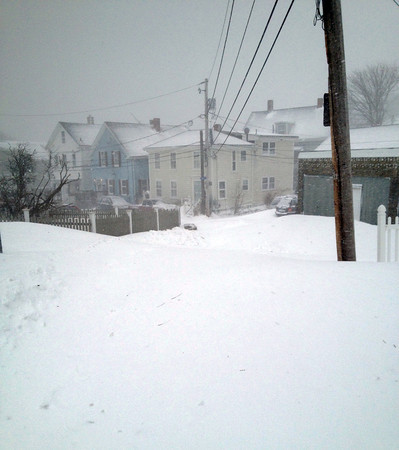Photo Courtesy Aaron and Melissa Miller/Gloucester Daily Times. The view from the Miller home on Mansfield Street during the snow storm on Saturday.