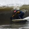Photo courtesy of Rob Bibelhauser. William Lawthor of Lanesville navigates a wave's barrel on Magnolia Beach on Monday during Hurricane Sandy.