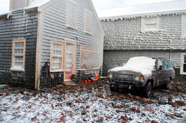 Photo courtesy of James Atkinson/Gloucester Daily Times. Snowbound Bearskin Neck, Rockport. Bricks are scattered around this home and other items overturned.
