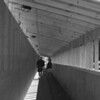 """<b>Submitted By:</b> Roslyn Lambert  <b>From:</b> Traverse City  <b>Description:</b> A couple walking through the """"tunnel"""" in downtown Traverse City."""