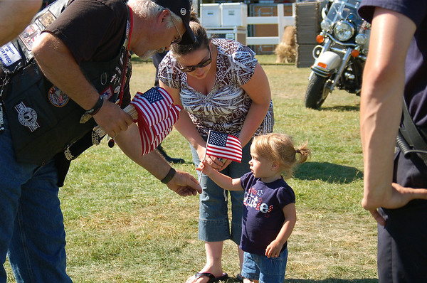 "<span style=""display:none"">Email: smelton40@yahoo.com</span> <b>Submitted By:</b> Susan Melton <b>From:</b> Beulah <b>Description:</b> Kaitlyn Posey of Traverse City receives her first American Flag during Heroes Day with mom Sarah standing by."