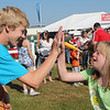 "<span style=""display:none"">Email: kimberlynewslady@yahoo.com</span> <b>Submitted By:</b> Kimberly Purdy <b>From:</b> Traverse City <b>Description:</b> A volunteer high fives a special kid on Special Kids Day in the Open Space."