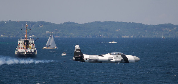 <b>Submitted By:</b> Jason Lome <b>From:</b> Traverse City <b>Description:</b> T33 zipping across the surface of west bay during the Cherry Festival Air Show. Taken from the mast of the Nauticat.