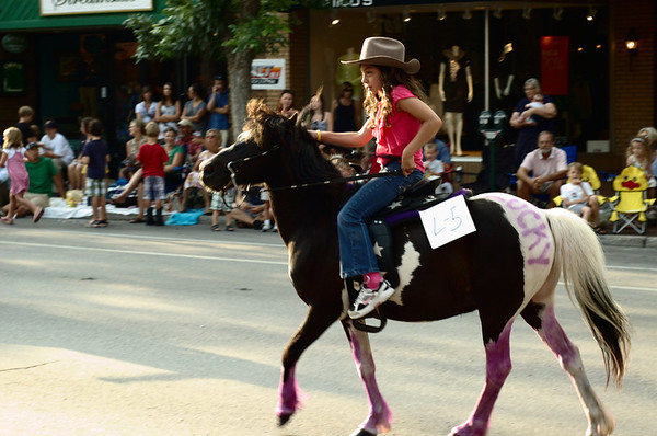 "<span style=""display:none"">Email: tiny.leviathan@gmail.com</span> <b>Submitted By:</b> Levi Gates <b>From:</b> Traverse City <b>Description:</b> A small girl rides a pony down Front St. during the parade on July 7th, downtown Traverse City."