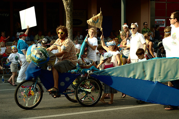 "<span style=""display:none"">Email: tiny.leviathan@gmail.com</span> <b>Submitted By:</b> Levi Gates <b>From:</b> Traverse City <b>Description:</b> A man rides a bike adorned as a dragonfly during the parade on July 7th, downtown Traverse City."