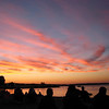 End of Cherry Festival Pre-Firework Sunset.<br /> Clinch Park Beach, July 12, 2008<br /> We found our spot long before sunset and enjoyed watching as the beach <br /> filled with families ready for the fireworks display.<br /> <br /> Carrie Pierson<br /> Bozeman, Montana (originally from Maple City, Michigan)