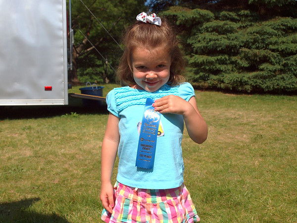"<span style=""display:none"">Email: skifam22@aol.com</span> <b>Submitted By:</b> Karen Plucinski <b>From:</b> Williamsburg, MI <b>Description:</b> 3 year old Keira Castle proudly showing her first place ribbon from the toddler trot. Taken Friday, July 8, 2011"