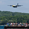 <b>Submitted By:</b> Peggy Zinn <b>From:</b> Traverse City <b>Description:</b> Fat Albert taking a Low Pass over the Pier, while fans eagerly enticepate a great show.