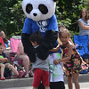 """<span style=""""display:none"""">Email: angie.shinos11@gmail.com</span> <b>Submitted By:</b> Angela Shinos <b>From:</b> Traverse City <b>Description:</b> Keeley and Urijah TwoCrow hugging what they think is """"Kung Fu Panda"""" during the Cherry Royale Parade, Saturday July 9th, 2011"""