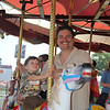 "<span style=""display:none"">Email: kimberlynewslady@yahoo.com</span> <b>Submitted By:</b> Kimberly Purdy <b>From:</b> Traverse City <b>Description:</b> A father of a special child enjoys the Merry Go Round on Special Kids Day just as much as his son."