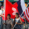 "<span style=""display:none"">Email: tiny.leviathan@gmail.com</span> <b>Submitted By:</b> Levi Gates <b>From:</b> Traverse City <b>Description:</b> Sierra Deeren, right, and a companion carry flags during the parade on July 7th, downtown Traverse City."