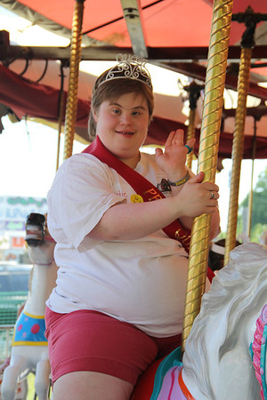"<span style=""display:none"">Email: kimberlynewslady@yahoo.com</span> <b>Submitted By:</b> Kimberly Purdy <b>From:</b> Traverse City <b>Description:</b> Special Olympics Michigan athlete Katie Sonnemann enjoys a ride on the Merry Go Round compelte with tiara and sash, and she even has the ""queen wave"" mastered!"