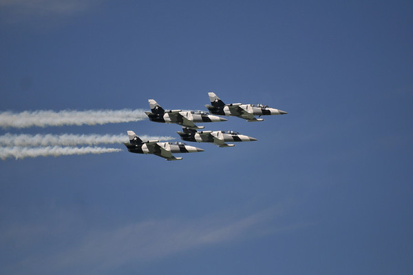 <b>Submitted By:</b> Ralph Epifanio <b>From:</b> Deland, Florida <b>Description:</b> Too close for comfort; flying in tight formation above Grand Traverse Bay during the 2011 Air Show, these non-military jets wowed the thousands of spectators lining its shores. Credit: Ralphoto