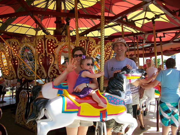 "<span style=""display:none"">Email: geriaval@yahoo.com</span> <b>Submitted By:</b> Geri Valentine <b>From:</b> Cedar <b>Description:</b> Carmella Valentine and her parents, Nello and Geri, enjoy the carousel on Special Kids Day. Taken 7/6/11."