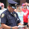 <b>Submitted By:</b> Richard Smith <b>From:</b> Traverse City <b>Description:</b> Office Looking through the Parade Guide during the Cherry Royal Parade 2011