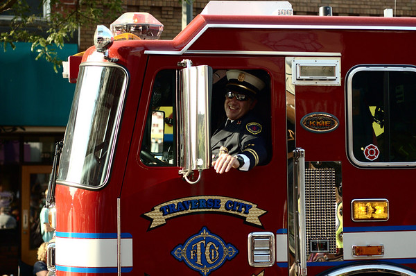 "<span style=""display:none"">Email: tiny.leviathan@gmail.com</span> <b>Submitted By:</b> Levi Gates <b>From:</b> Traverse City <b>Description:</b> A firefighter smiles to the crowd during the Parade."